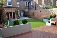modern garden design artificial grass raised beds hardwood