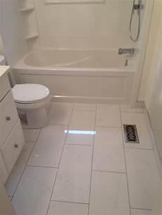 Ceramic Tile Ideas For Small Bathrooms 12 X 24 Ceramic Tile For The Floor White Cabinet Tub