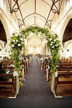 a floral arch in the church love this wedding ceremony