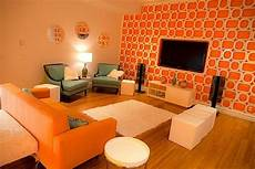 designing and decorating the orange living room for the stylish yet inviting midcityeast