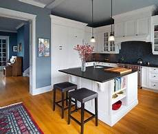 kitchen bright blue walls white cabinets subway tile absolute black granite counters grey