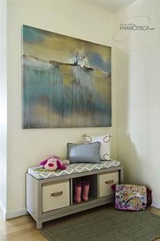 beautiful foyer with pale yellow walls paint color blue yellow landscape canvas painting