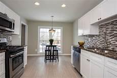 white shaker kitchen cabinets galley style kitchen