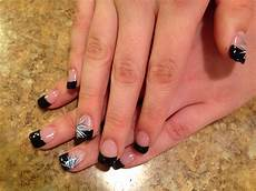 black french tip nails with flower design i want the