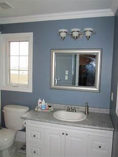 beautiful bathroom with grey accent and modern style beautiful chrome polished 3 light vanity