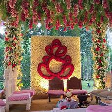 love this red floral ganesh decor under a floral mandap at