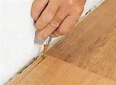 comment poser parquet stratifié comment ajuster des lames de parquet le du mur