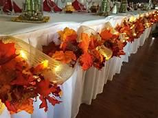 fall wedding decor head table leaves burlap lights easy diy created using long garland of fall