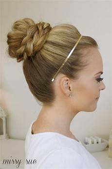 How To Do A High Bun Hairstyle braid wrapped high bun