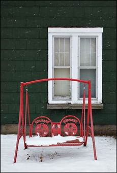 coca cola swing coca cola porch swing in front of an house in a