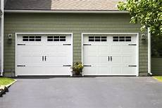 E Garage Door carriage house model ch5 in white with handles and