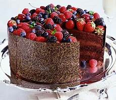 chocolate and berry cake wrapped with an edible chocolate transfer sheet chocolate transfer