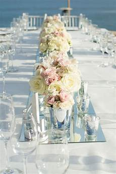 low centerpieces with wall to wall mirrors see the
