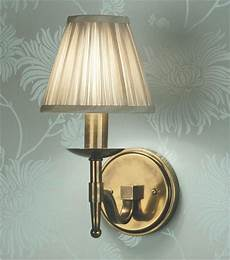 single or double arm brass wall light