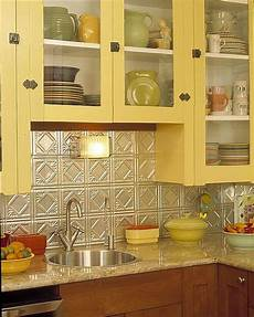 the yellow and the tin tile back splash i