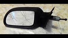 como cambiar espejo retrovisor coche