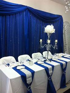 head table with royal blue back drop and crystal step curtains wedding tablecloths royal blue