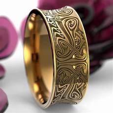gold engraved norse wedding ring with dramatic design in