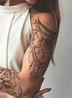 Floral And Ornamental Arm Arm Tattoos