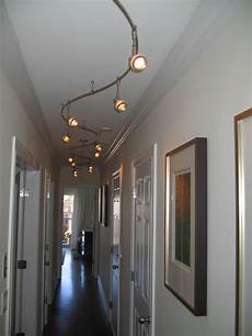fantastic interior hallway design with white wall decoration also curve track lighting fixtures
