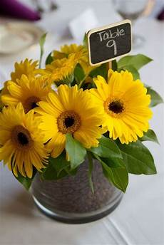 yellow gerbera daisy centerpiece with coffee bean detail