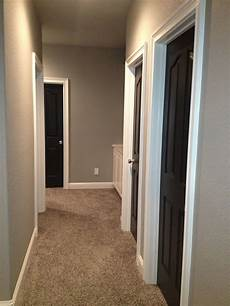greige walls and black doors rare to find a photo with carpet seems everyone has floors