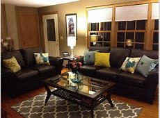 Brown leather sofa and colorful pillows. Funky living room