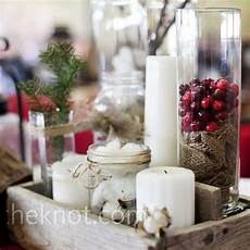 rustic winter centerpieces glass cylinders and jars
