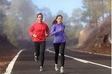 fitness male and female healthy running runner man and woman workout stock photo