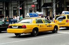 new york yellow taxi cabs in motion stock