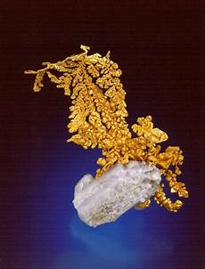gold in it s crystal form because gold is so soft it is usually found in rounded nuggets veins