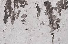 Betonmauerbeschaffenheit Mit Pflaster Und Lack Stockfoto