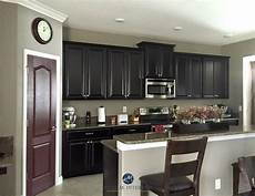 sherwin williams keystone gray in a kitchen with espresso dark cabinets sommelier painted
