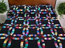 almost amish double wedding ring quilt