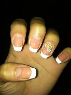 french tip with flowers on the ring finger cute nail