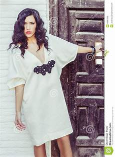 woman model of fashion wearing white dress with curly