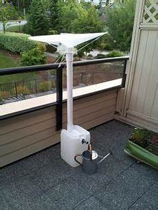 Rainsaucers To Collect Rainwater On A Balcony For