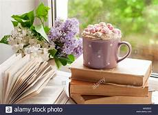 fiori coffee coffee cup with marshmallow open book and flowers bouquet