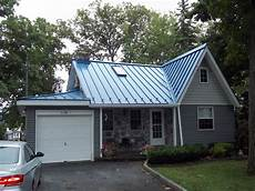 blue metal roof charming lakehouse cottage exterior house colors metal roof houses house