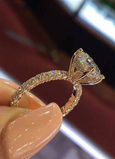 14 karat rose gold diamond under halo wedding ring with