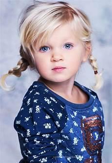 little blonde girl in pigtails darlings easy little