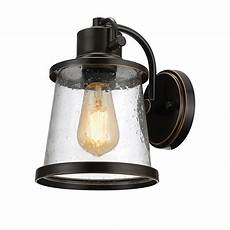 globe electric 1 light rubbed bronze outdoor indoor wall sconce with clear seeded