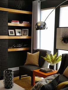 charcoal gray walls paint color charcoal gray wingback modern chairs yellow chevron pillows