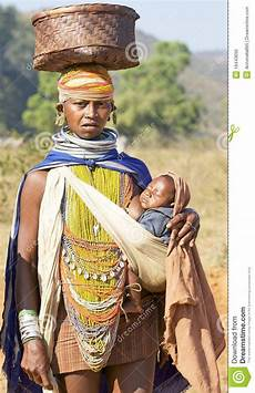 Orissan Tribal Carryng A Baby Editorial Image