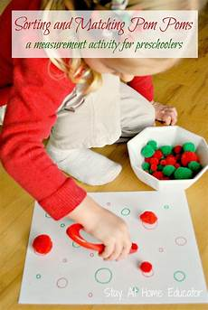 sorting and matching pom poms a preschool measurement activity stay at home educator