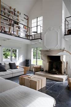 tall living room with a library balcony in a restored home