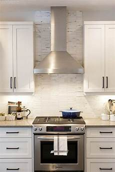 white ceiling fan subway kitchen backsplash ideas a rustic modern white kitchen by calgary interior