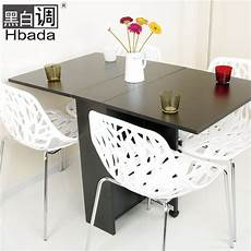 small apartment with foldaway table modern minimalist black and white tone retractable