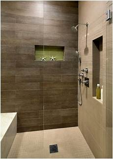 shower with brown tile and light floor