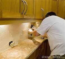 ceramic tile installation on kitchen backsplash 12 stock